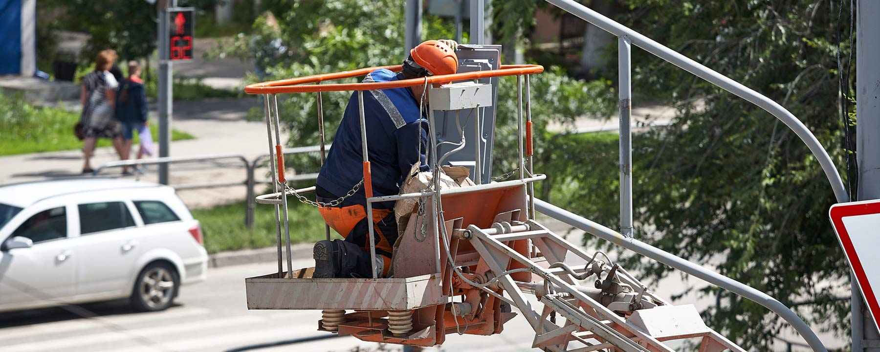 man working in bucket lift